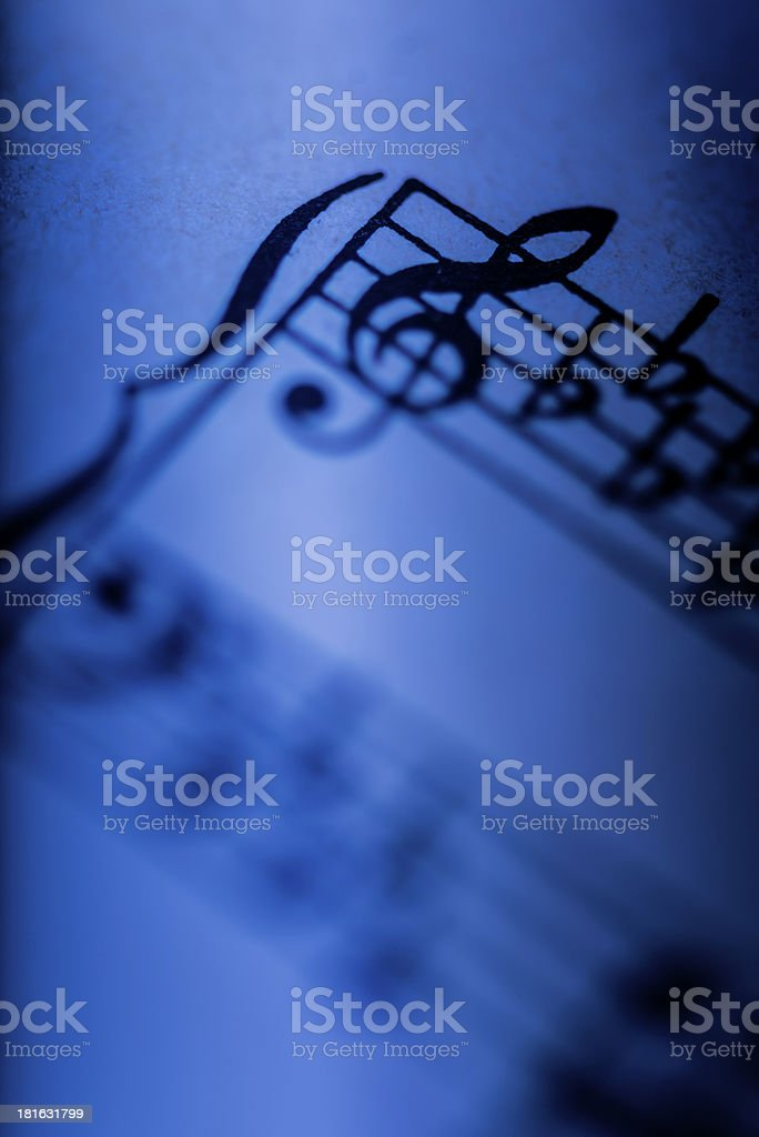 Sheet music in blue royalty-free stock photo