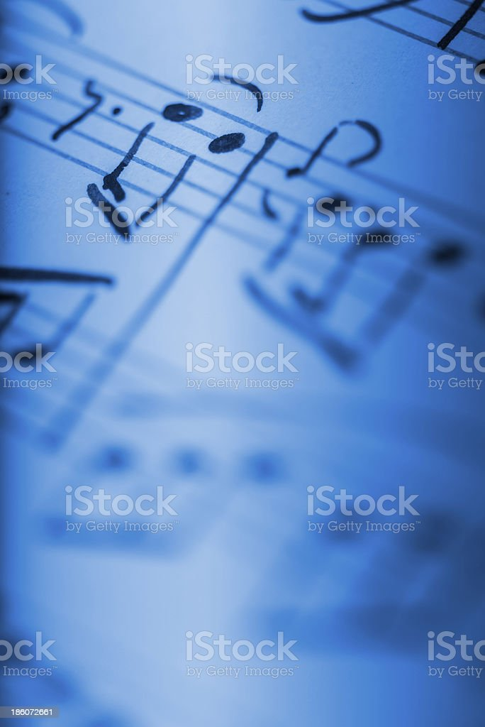 Sheet music in blue stock photo