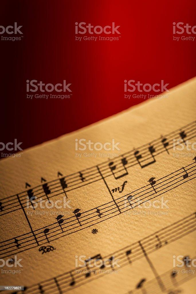 Sheet music on red velvet stock photo
