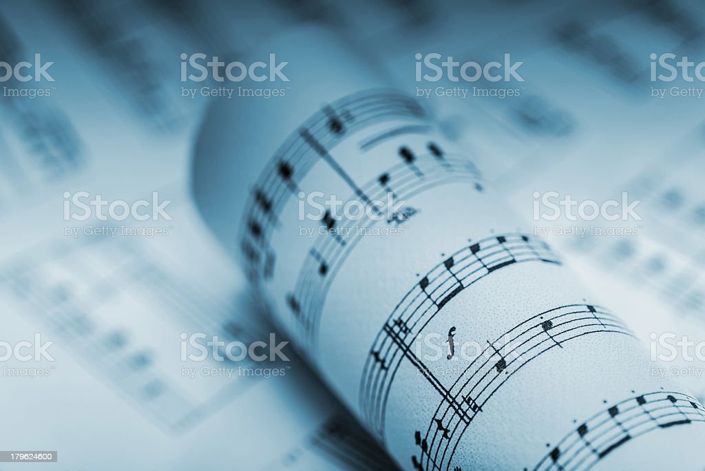 Sheet music rolled up royalty-free stock photo