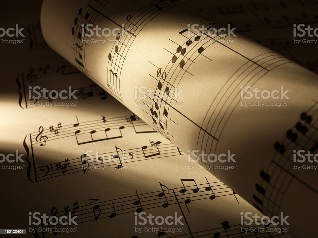 Sheet music with shadow stock photo