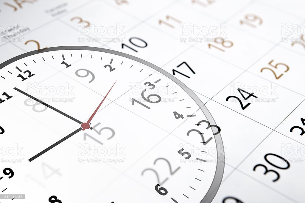 sheet of a calendar with the number of days and clock stock photo