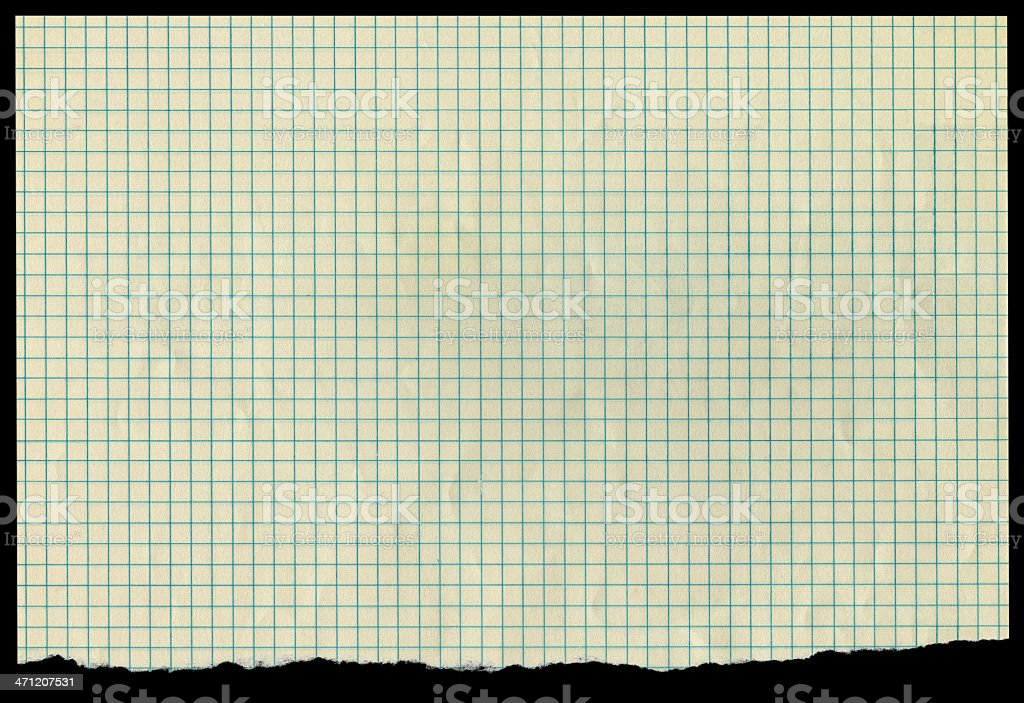Sheet of Old Discolored Graph Paper With Ragged Tear royalty-free stock photo