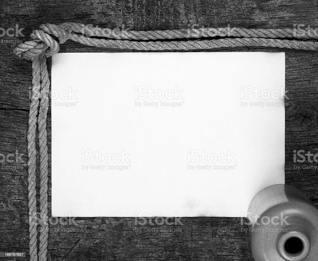 Sheet of old paper with a bottle royalty-free stock photo