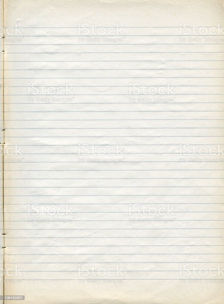 Sheet of old slightly yellowed lined note paper stock photo