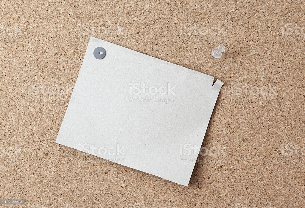 Sheet of paper attached to a pushpin noticeboard. royalty-free stock photo