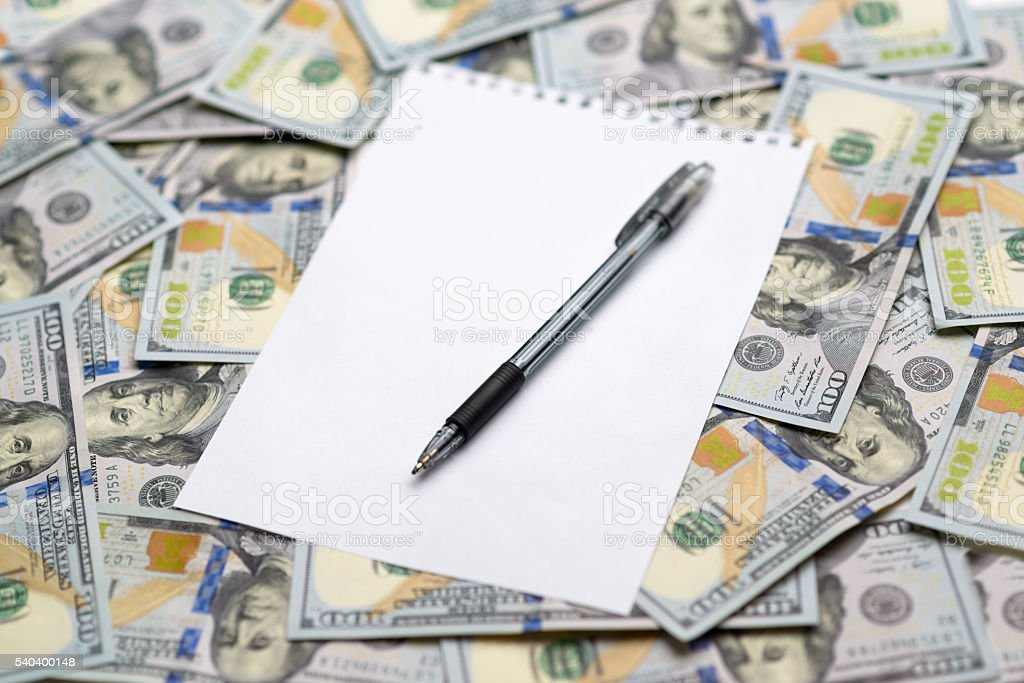 sheet of paper for notes with a pen stock photo