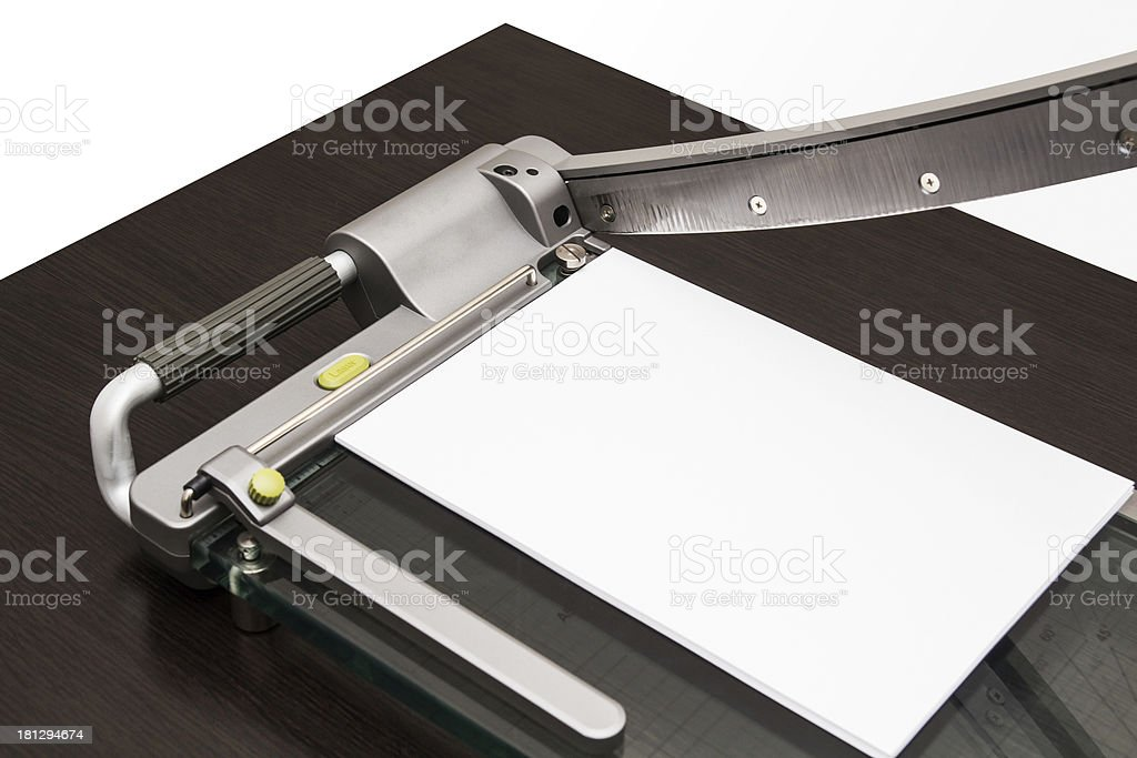 Sheet of paper in the guillotine stock photo