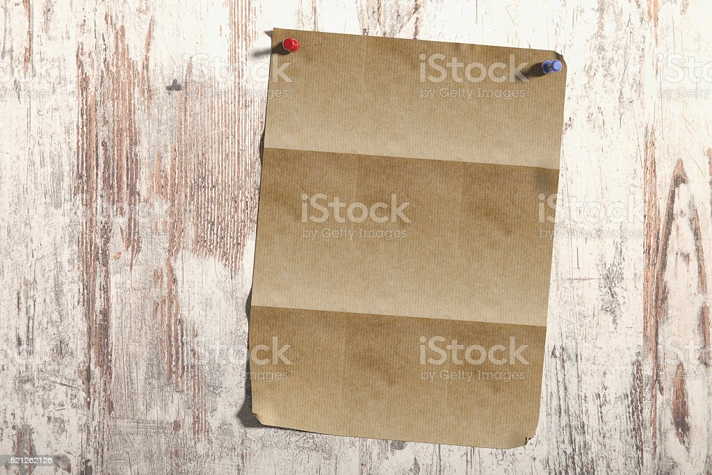 Sheet of paper on wooden plank stock photo