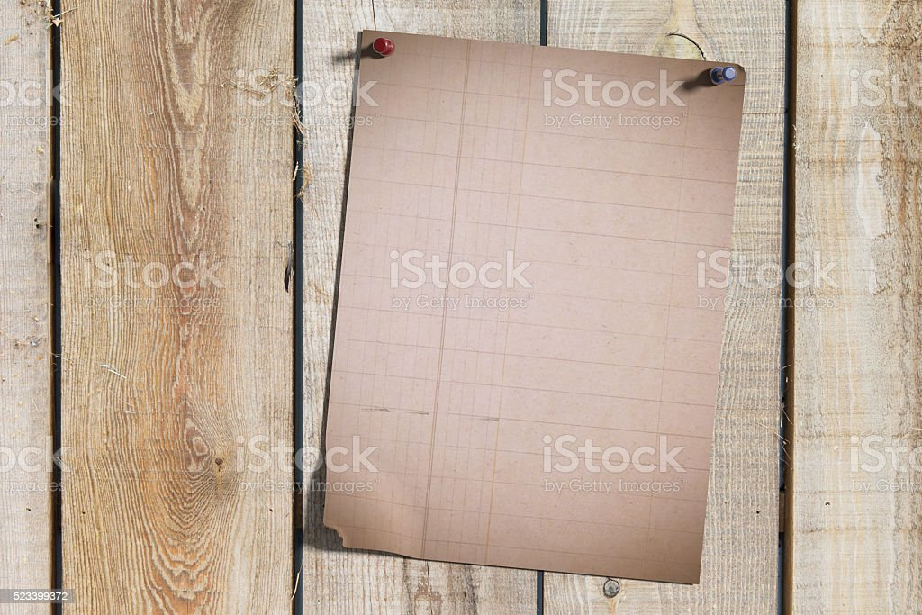 Sheet of paper on wooden planks stock photo