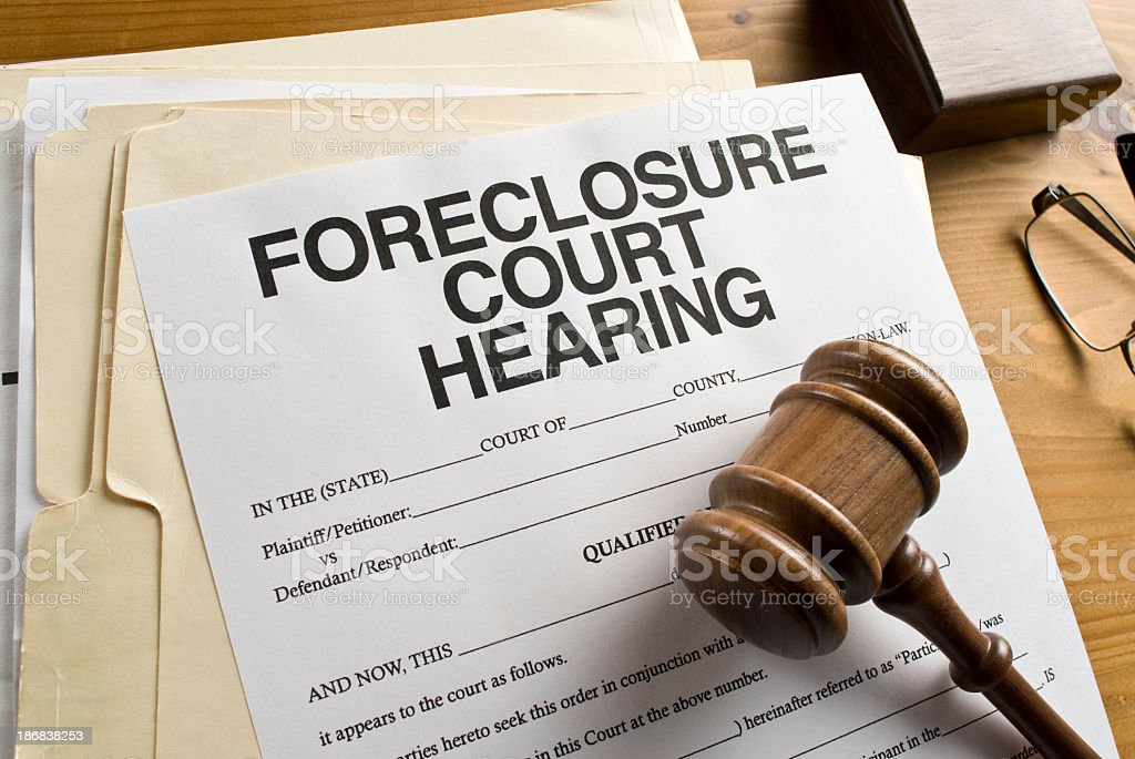 A sheet of paper that is a foreclosure court hearing stock photo