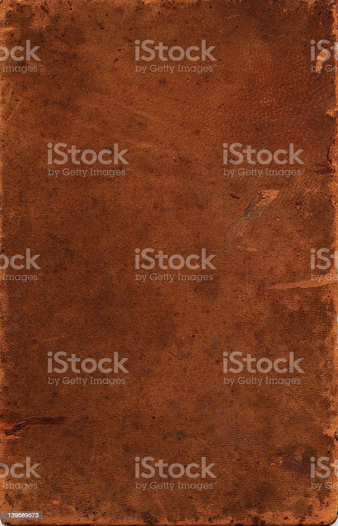 Sheet of vintage leather against black background royalty-free stock photo