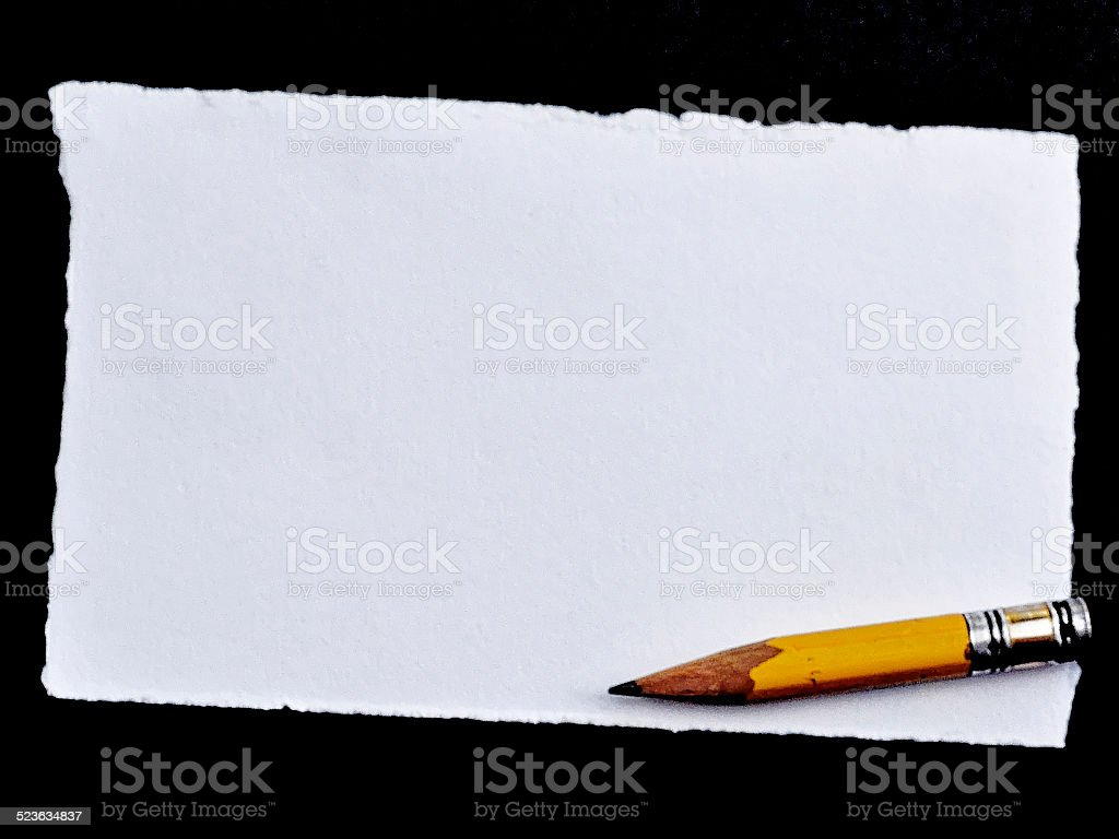sheet of white paper with pencil stock photo