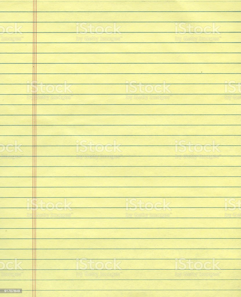 Sheet of yellow ruled paper stock photo