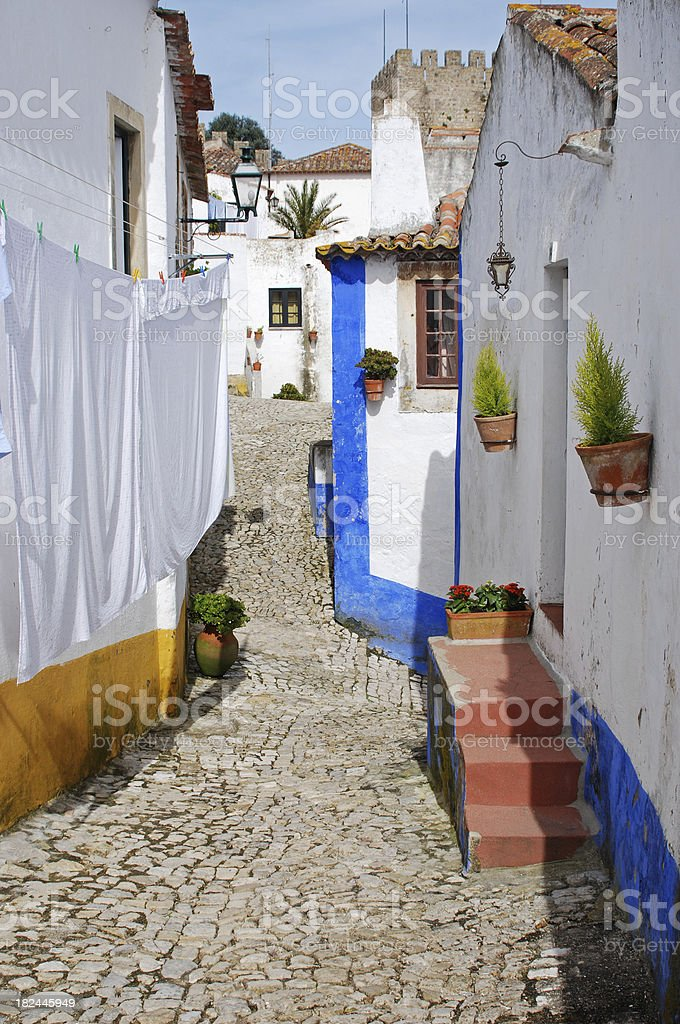 Sheets drying between houses in Portugal royalty-free stock photo