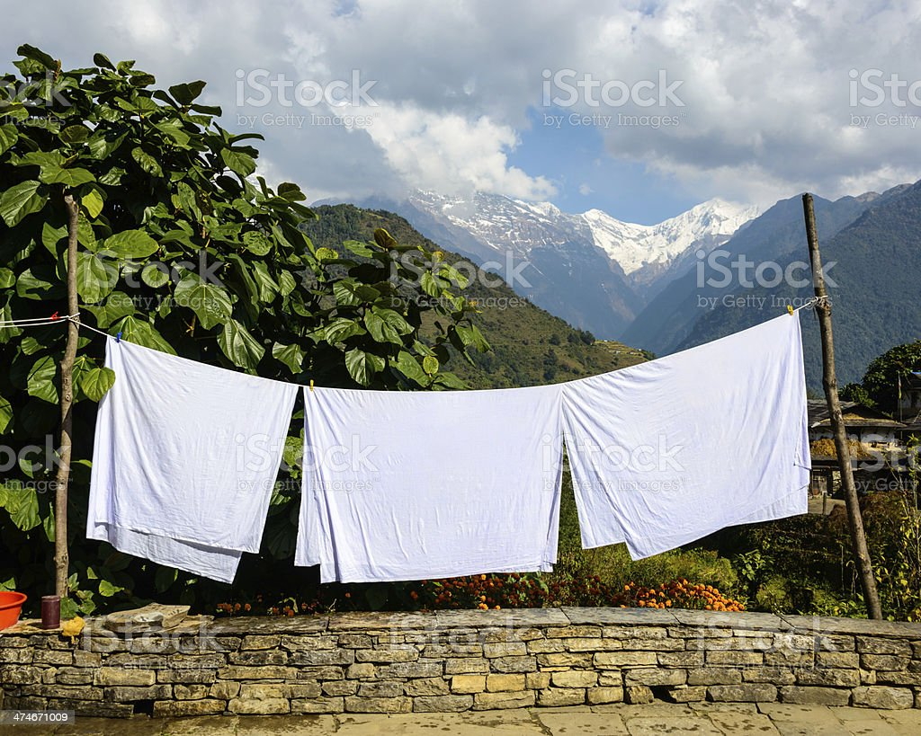 Sheets drying in the sun stock photo
