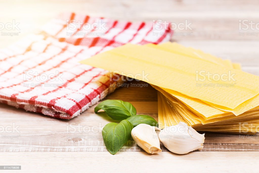 Sheets for lasagna with  parsley leaves stock photo