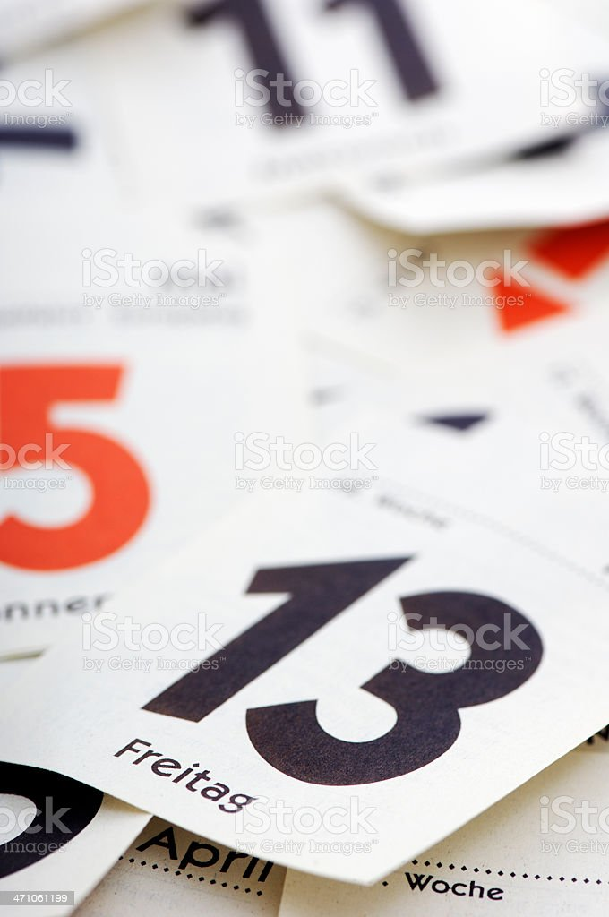Sheets of a tear-off calendar/ Friday 13th royalty-free stock photo