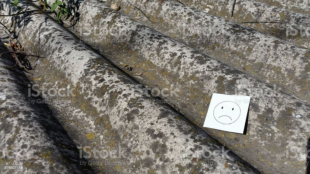 sheets of asbestos cement in the city center stock photo