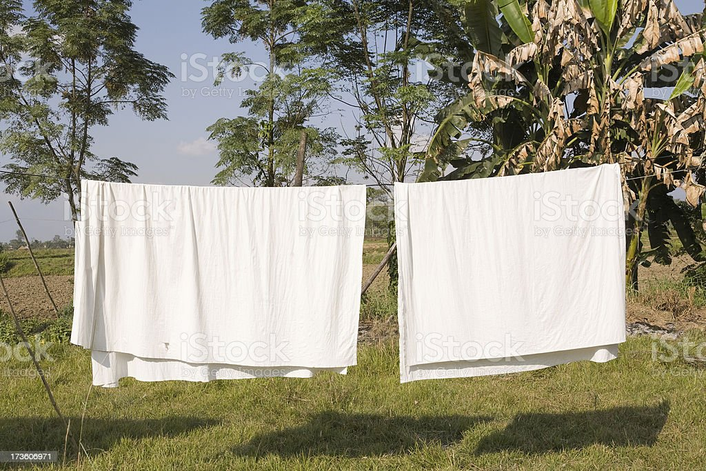 Sheets on a clothes line royalty-free stock photo