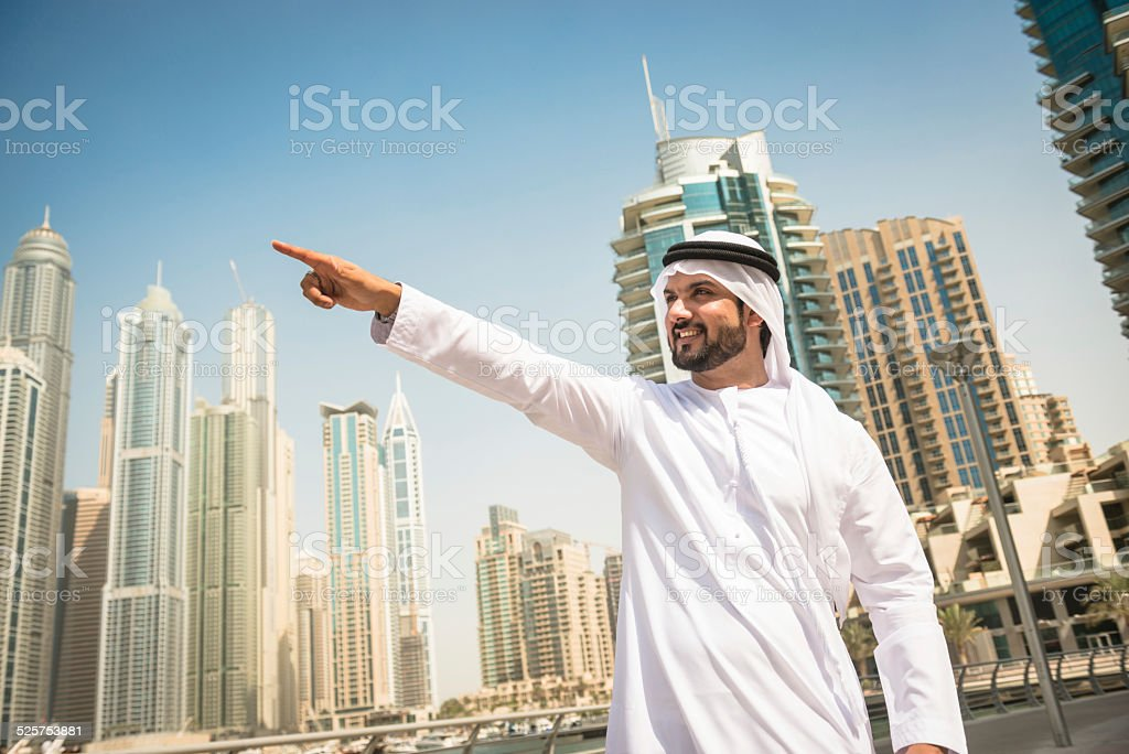 sheik aiming something in dubai marina stock photo