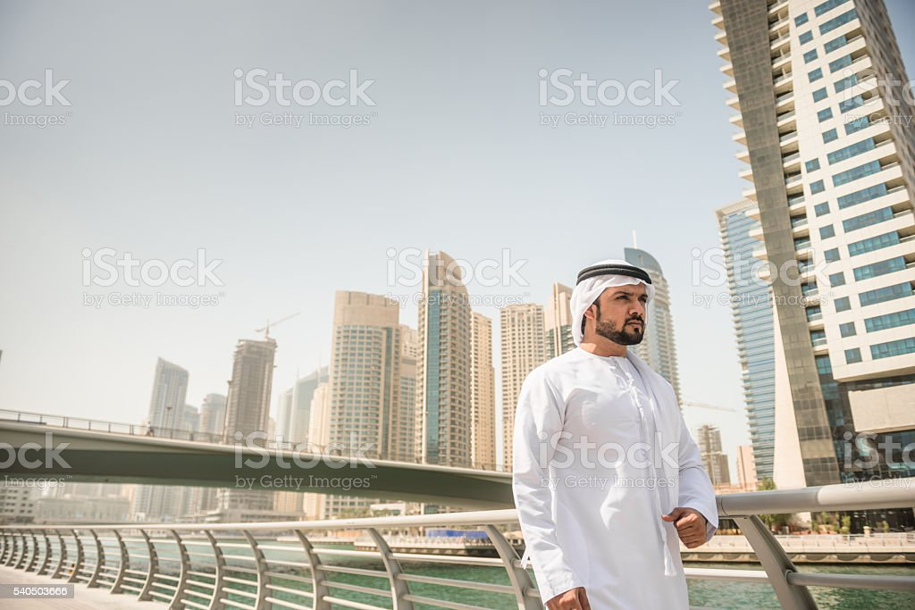 sheik twalking on the marina stock photo