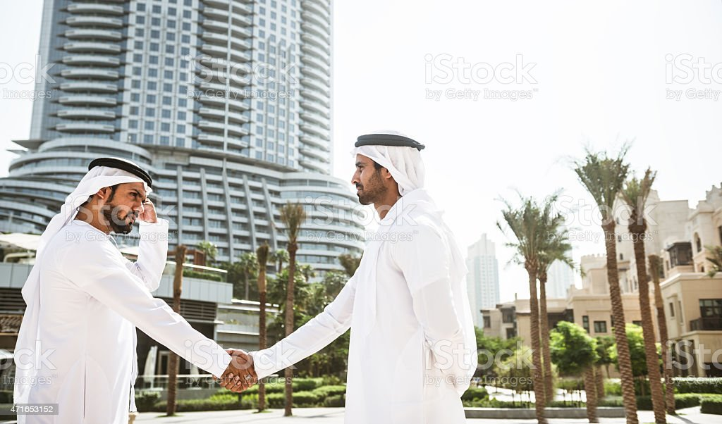 sheikh doing a deal in UAE stock photo