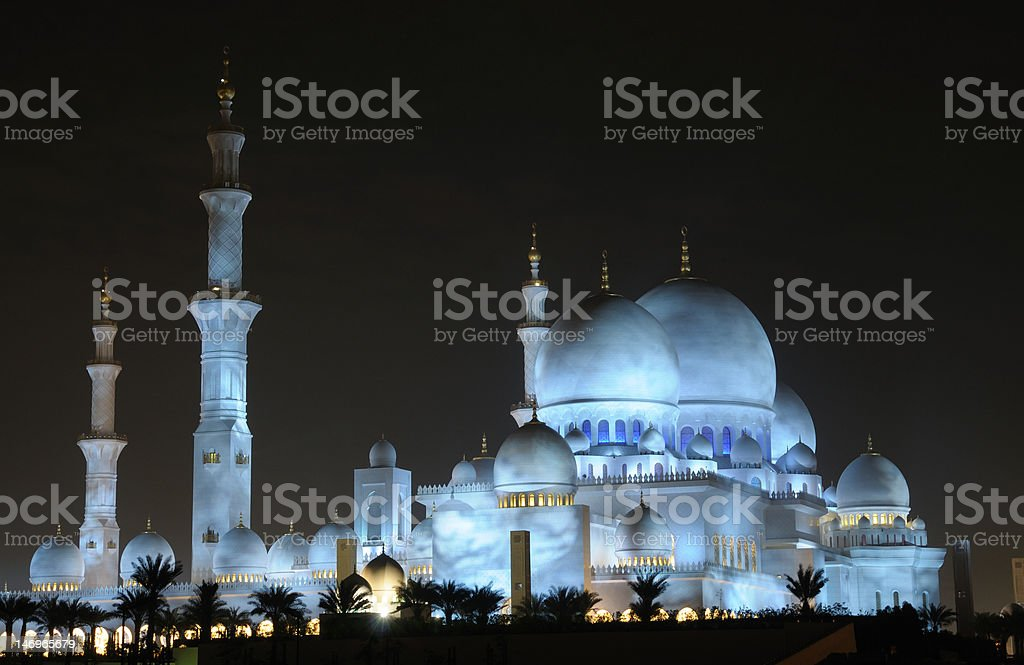 Sheikh Zayed Mosque illuminated at night stock photo