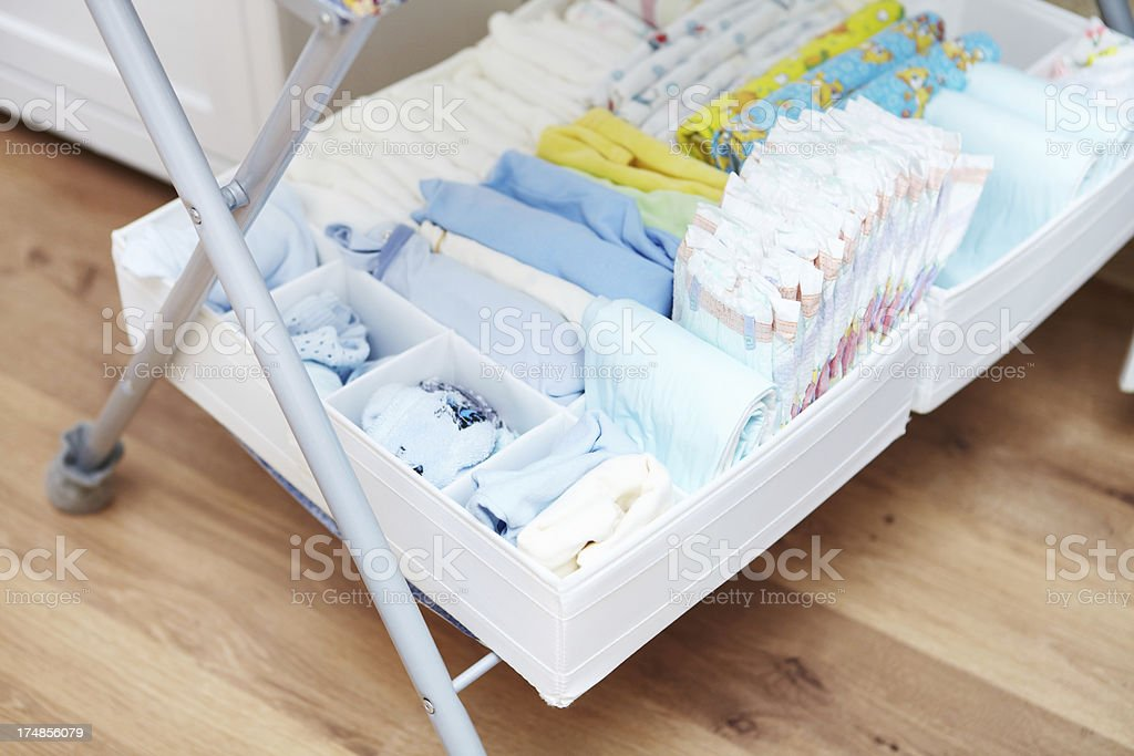 Shelf for baby clothes. stock photo