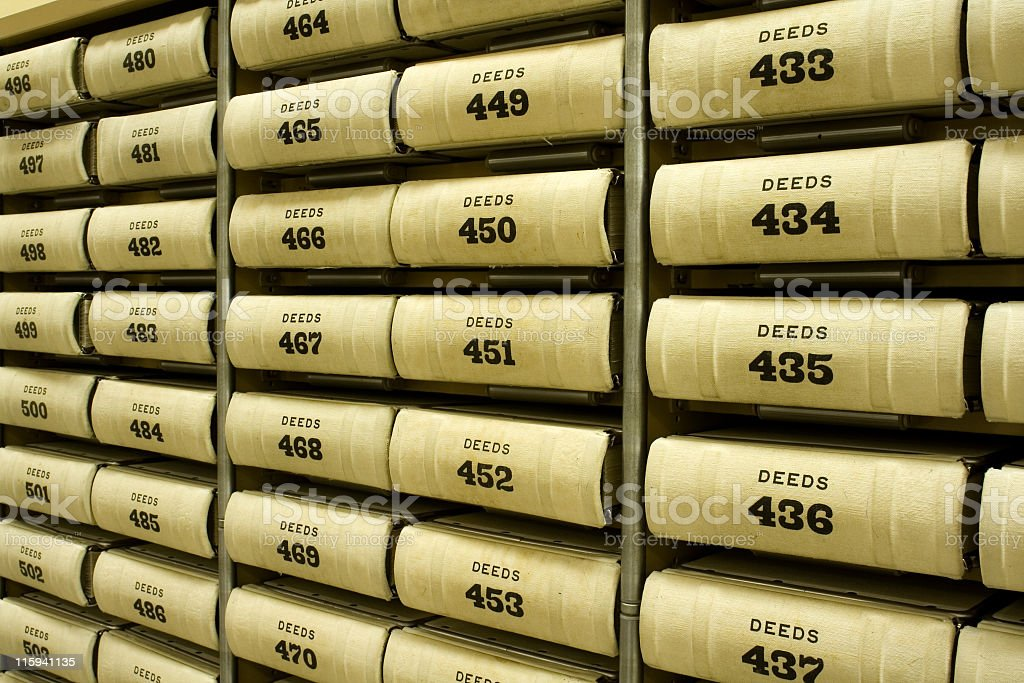 A Shelf full of numbered deeds stock photo