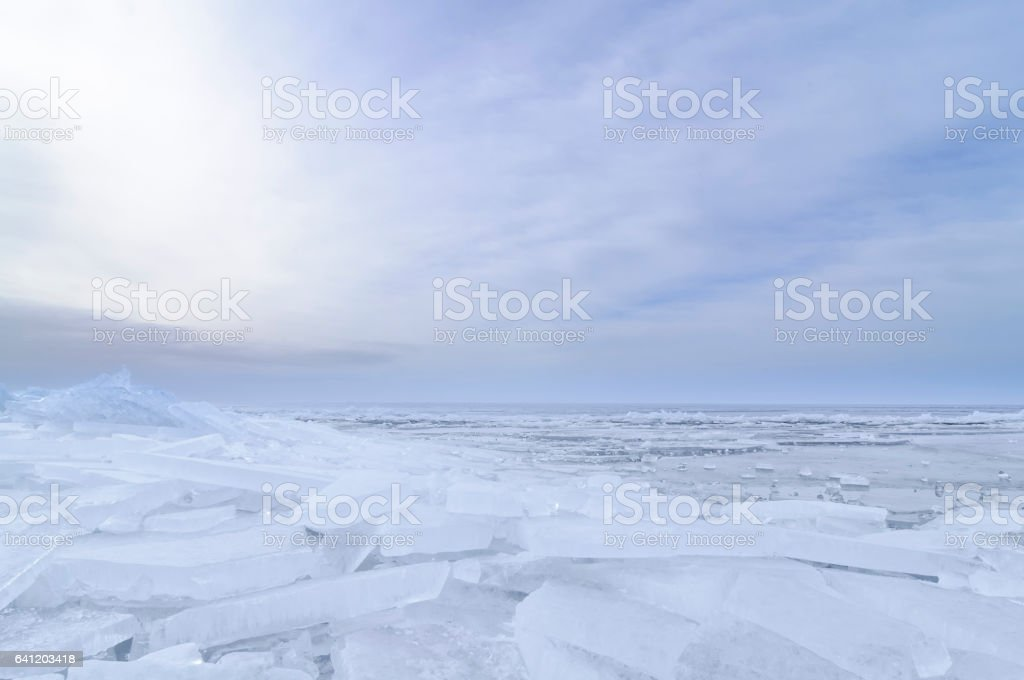 Shelf ice washed up on shore in winter stock photo