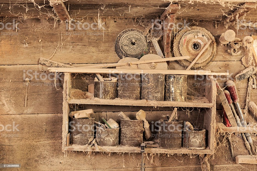 Shelf in carpentry with tools and wood workpieces stock photo