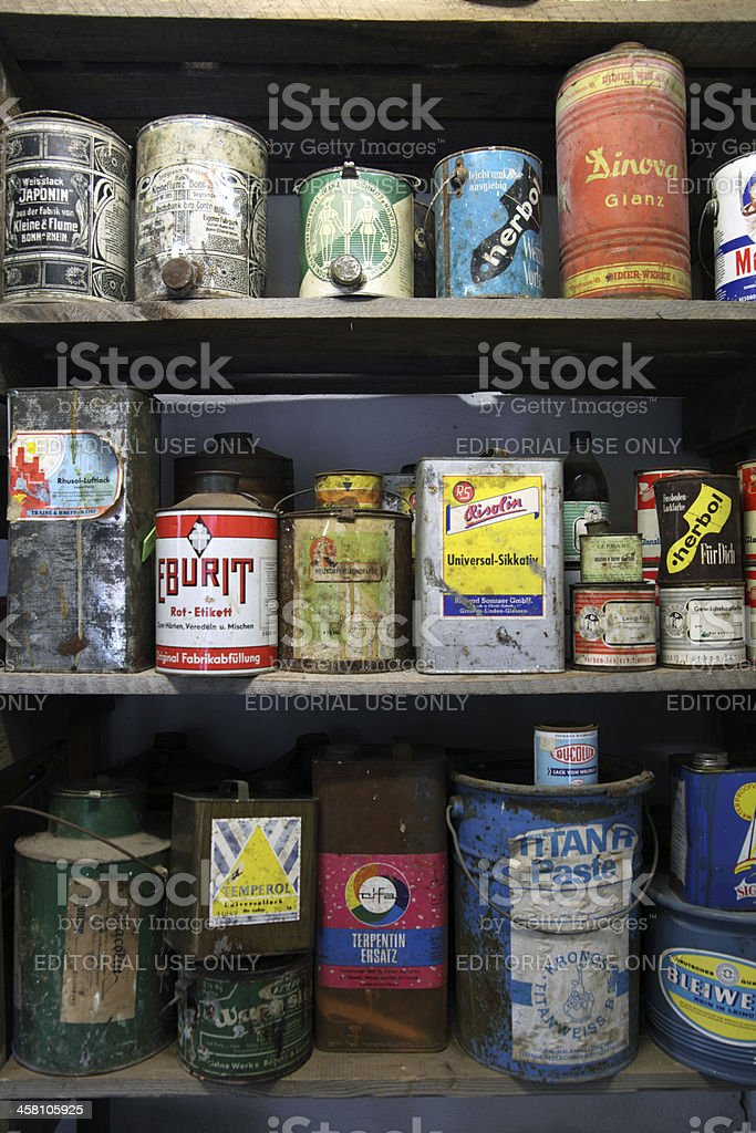 Shelf of 80s chemistry canisters stock photo