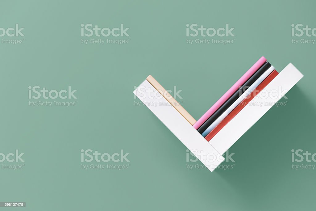 Shelf of books on wall stock photo