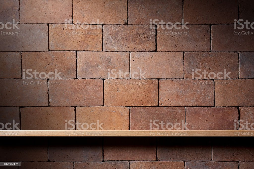 Shelf on the wall of bricks royalty-free stock photo