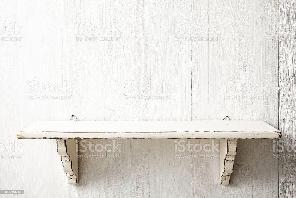 Shelf on white painted wood background royalty-free stock photo