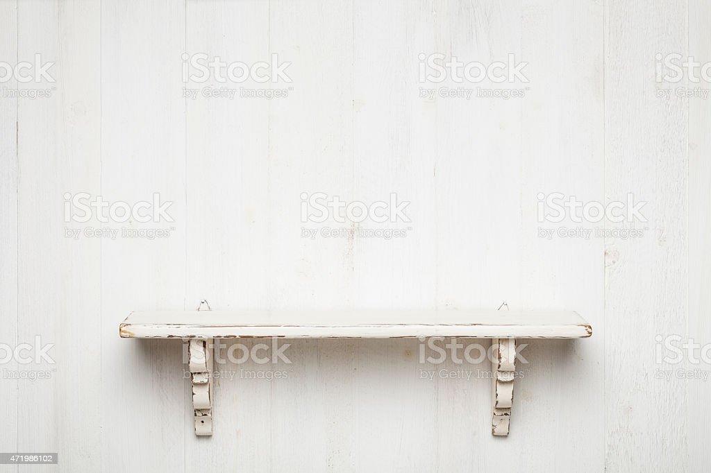 Shelf on white painted wood background stock photo