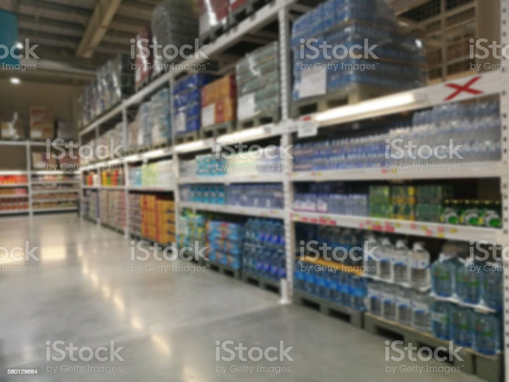 shelf supermarket  in blurry for background stock photo