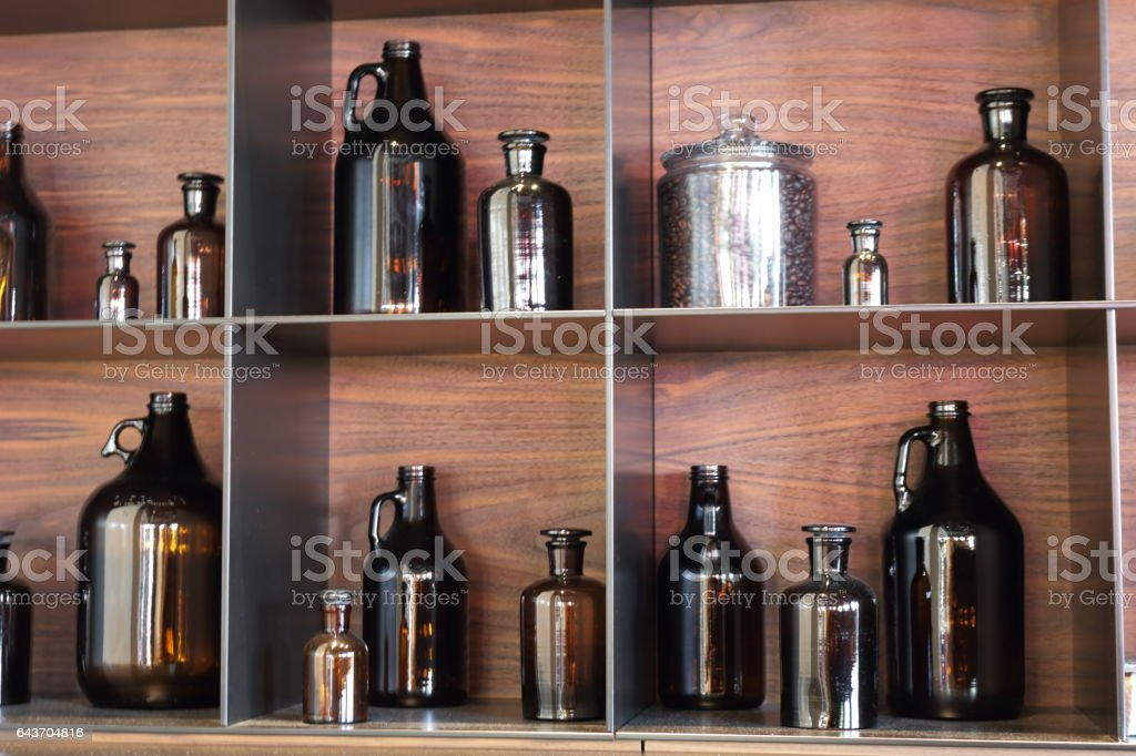 Shelf with a bottles. stock photo