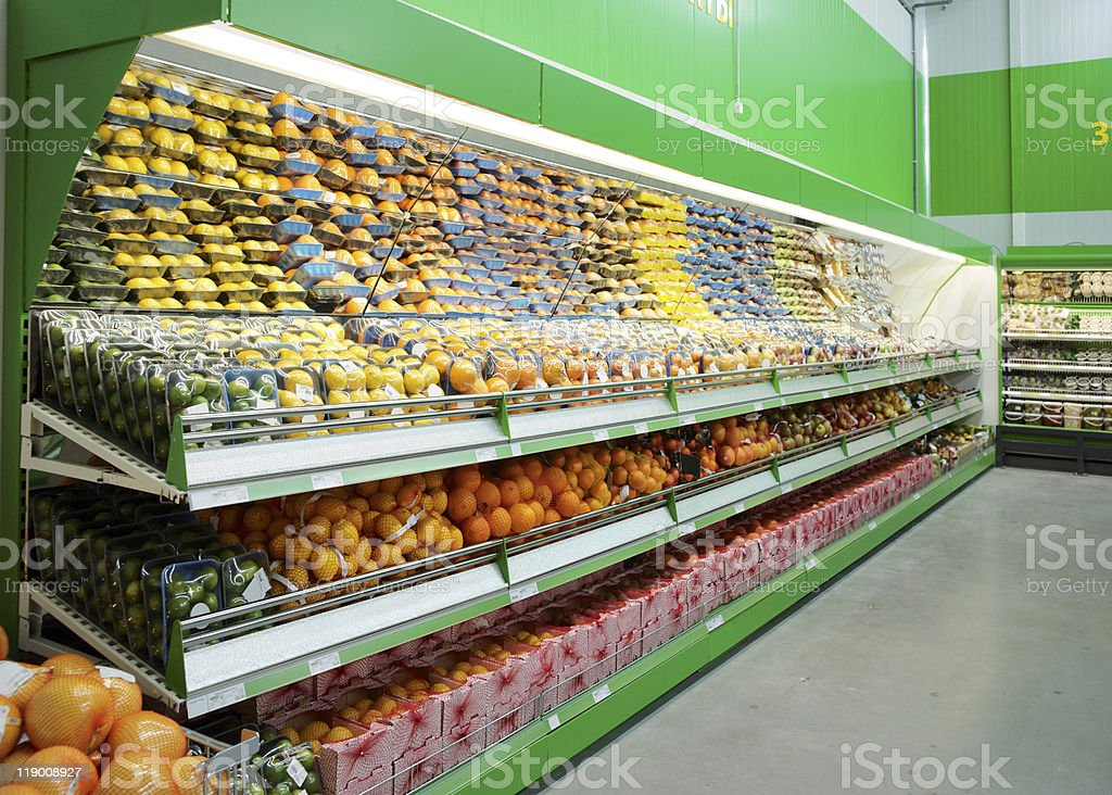 Shelf with citrus fruits in supermarket royalty-free stock photo