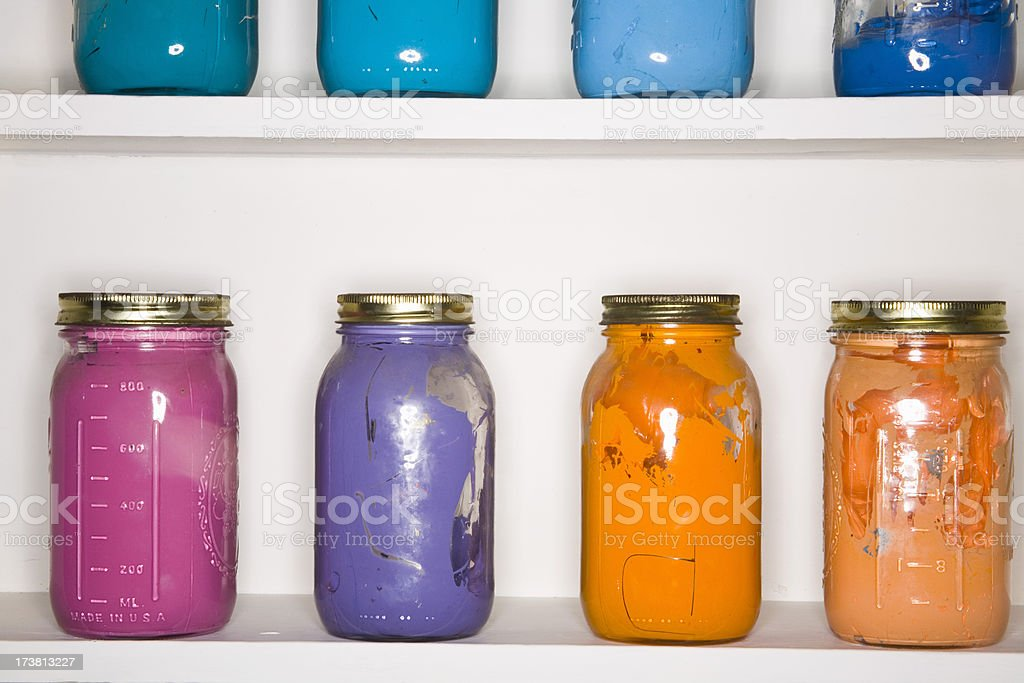 Shelf with Colorful Jars of Printer's Ink royalty-free stock photo
