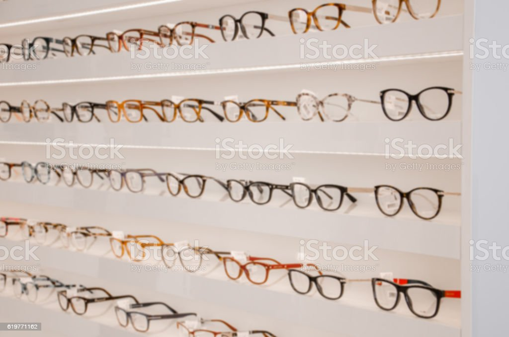shelf with glasses in the shop,soft focus stock photo