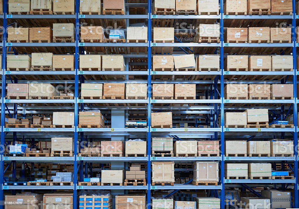 Shelfs in warehouse aisle stock photo