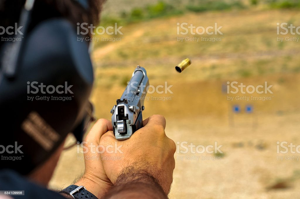 Shell  9mm ejecting from a gun stock photo