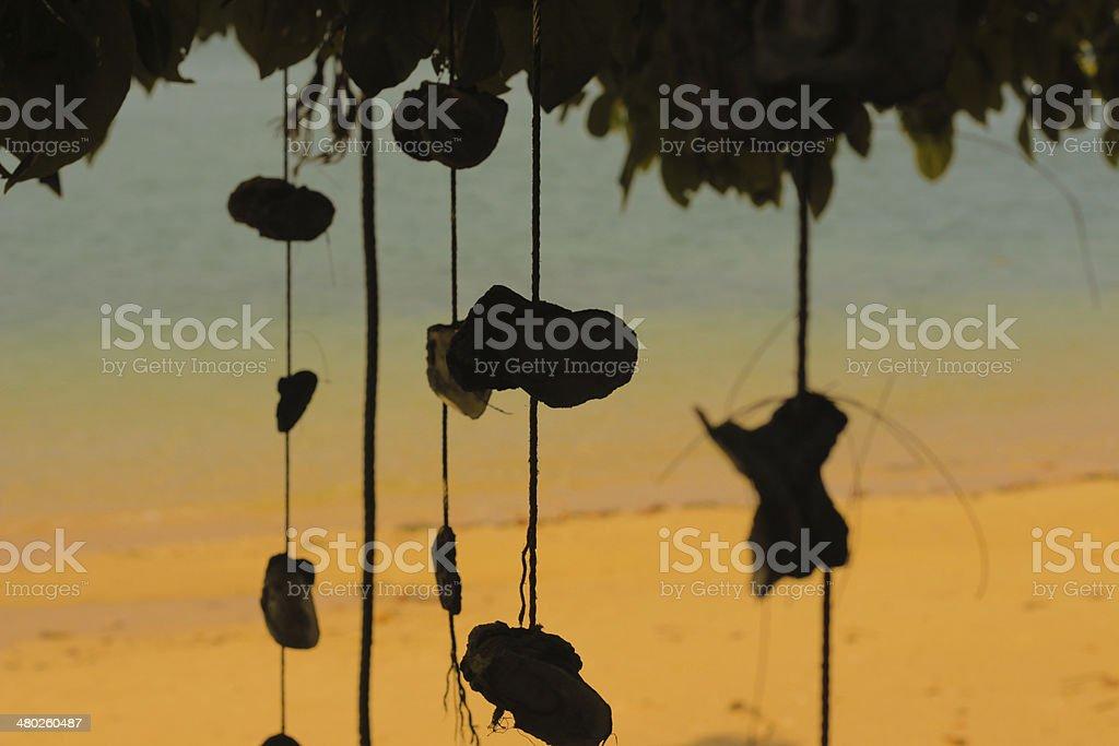 Shell curtain art hanging at Beach stock photo