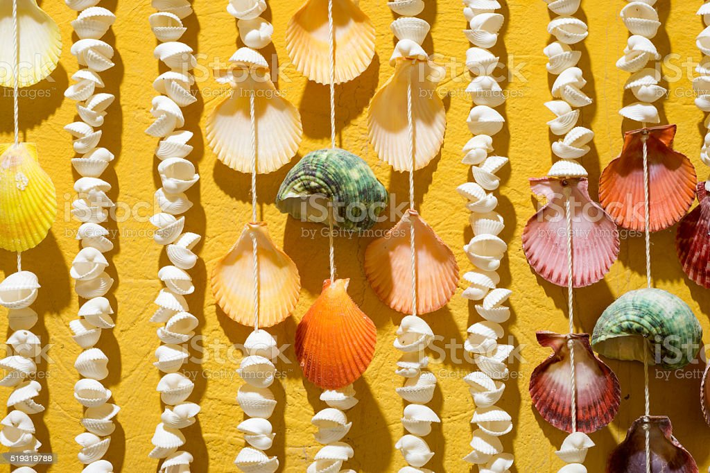 Shell Curtain on Yellow Wall stock photo