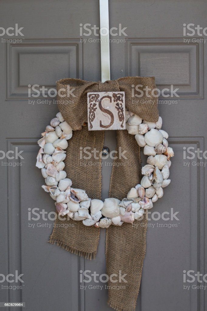 Shell door wreath with letter S stock photo