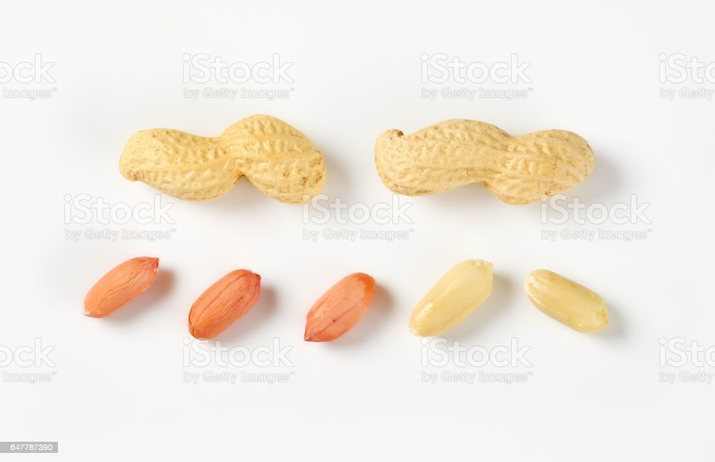 Shelled and unshelled peanuts stock photo
