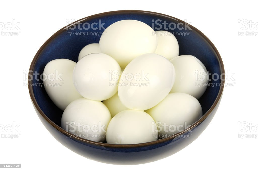 Shelled Hard boiled eggs in bowl stock photo