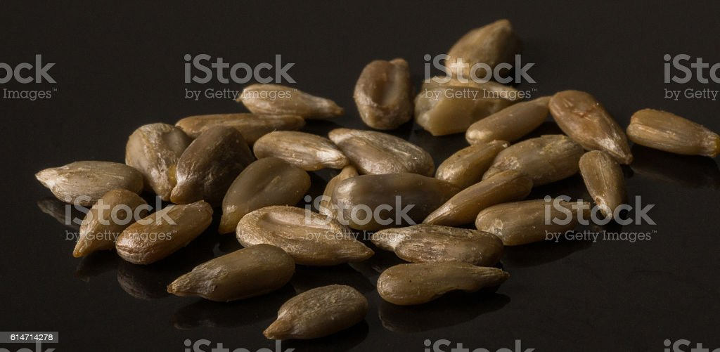 Shelled Sunflower Seeds  on black Background stock photo